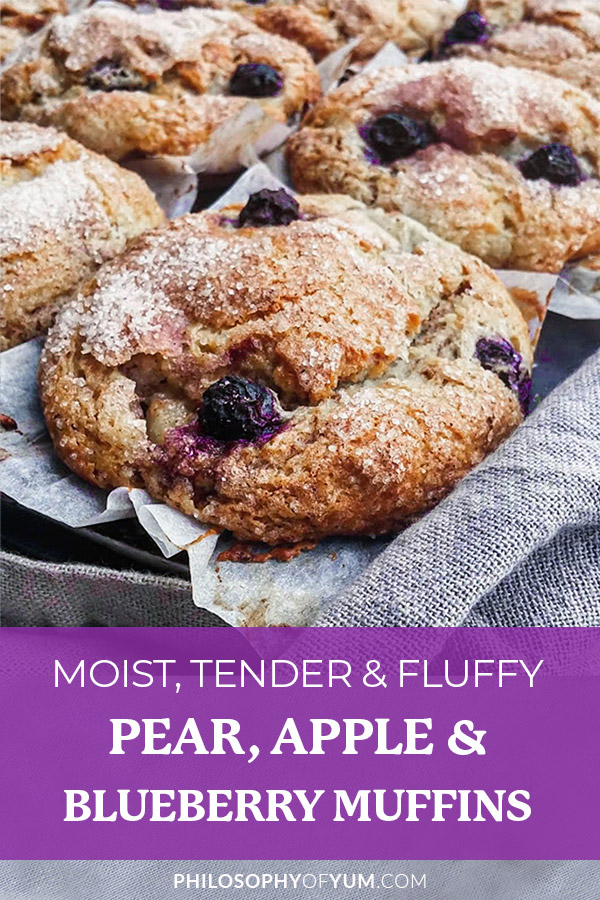 These Pear, Apple & Blueberry muffins are so light, tender and moist! A perfect fall muffin recipe to put on your fall home baking list. Great muffins for an on-the-go healthy breakfast. The crunchy cinnamon sugar crust on top pairs perfectly with the muffin's soft crumb underneath. And the bursts of fresh, dark blue-purple blueberries throughout the muffins is oh so delicious! #blueberrymuffins #fallrecipes #fallbaking #muffins #muffinrecipes