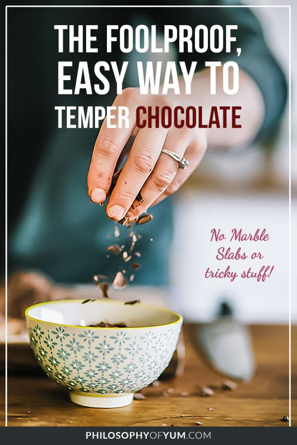 Who has the patience for a marble slab?? Ugh! Save yourself the agony and learn how to temper chocolate the EASY way! It's a method that no one ever talks about and it will make your baking and cake decorating so much easier. Click through to see the easiest way to temper chocolate. #cakedecoratingtips #bakingtipsandtricks #chocolatedecorations #temperchocolate