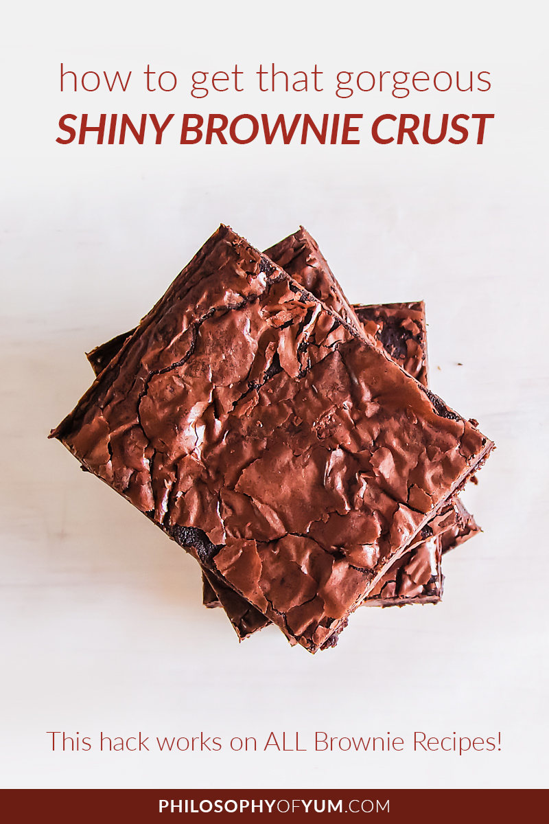 Get a gorgeous SHINY crust on ANY chocolate brownie recipe! That paper thin shiny crust really takes brownies to the next level. Click through to discover how you can do it too! #shinybrownies #shinycrustbrownies #brownierecipe #chocolatebrownies